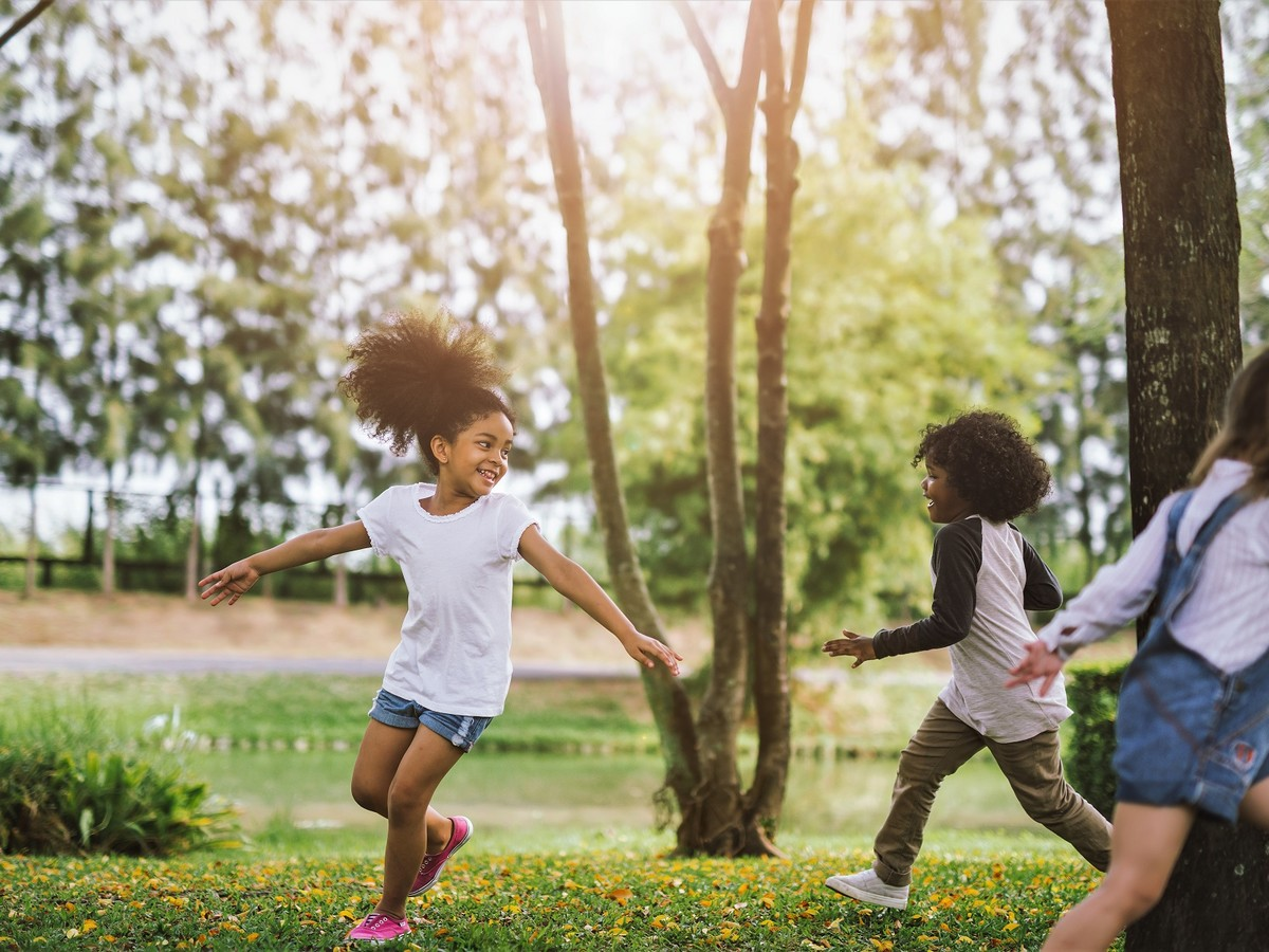 Kids Who Spend More Time Outside Are Happier Adults, Science Says shutterstock_1017803569