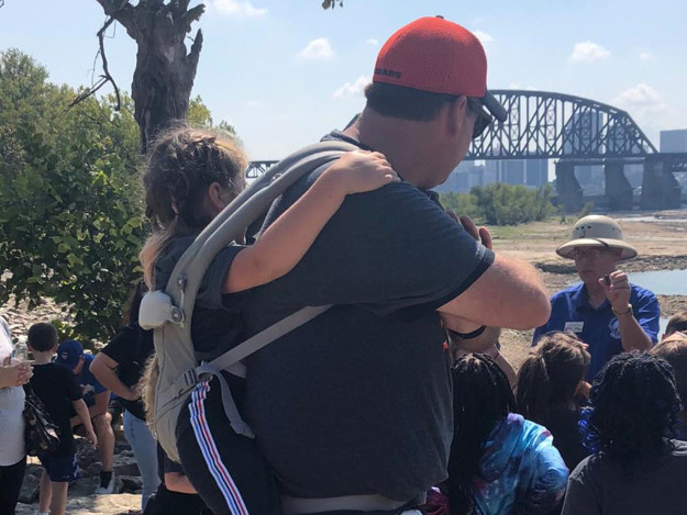 teacher carries student on field trip