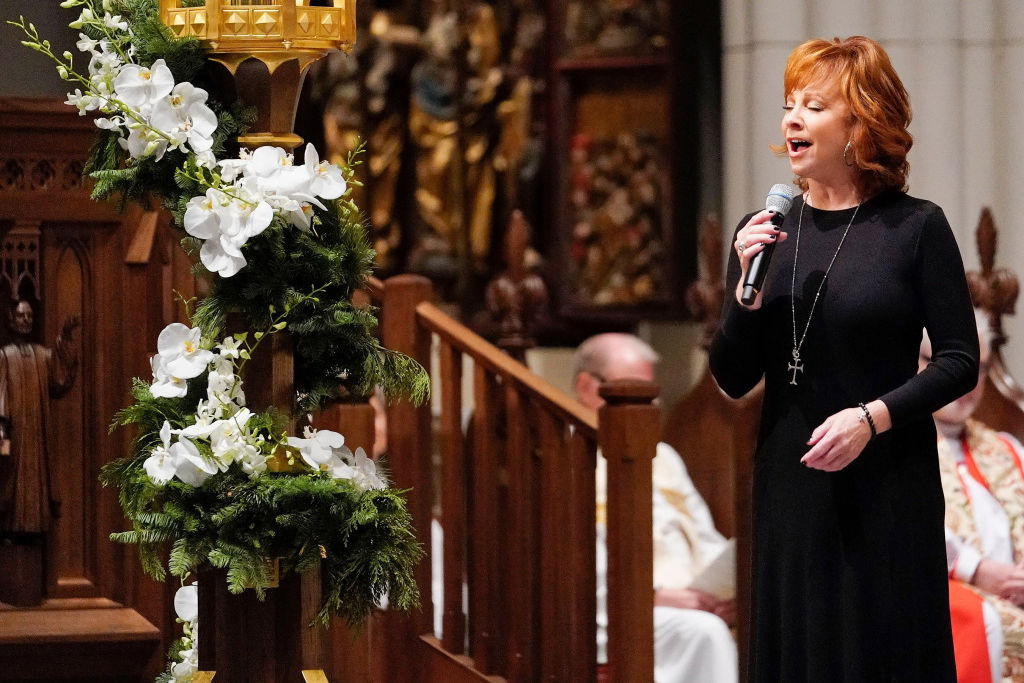 Reba McEntire's Touching Performance at George H.W. Bush's Funeral Brings His Grieving Son to Tears